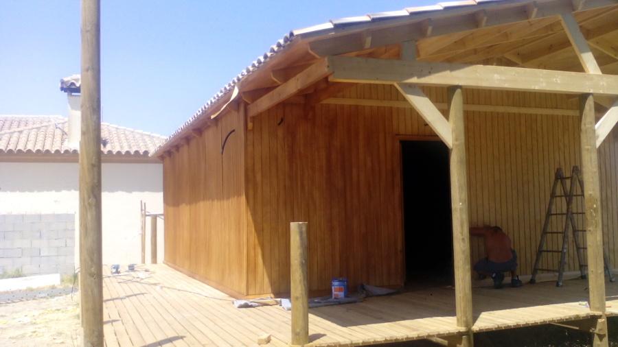 casa de madera con teja cerámica