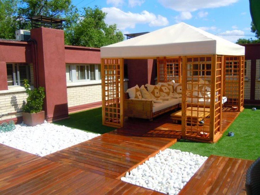 Ideas para el c sped ideas jardineros - Jardines de casas particulares ...