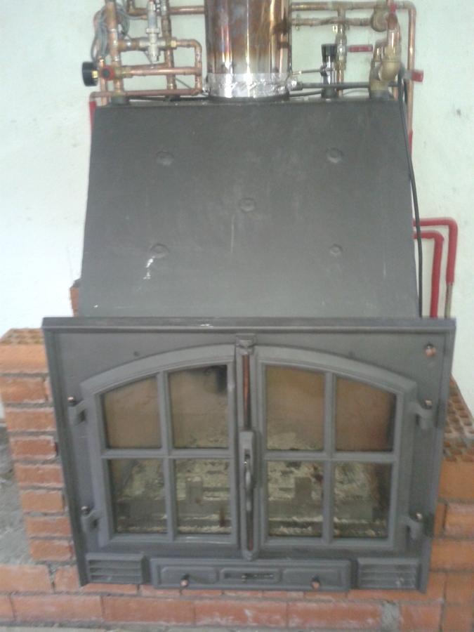 Foto chimenea de le a insertable para la calefacci n por - Como colocar una chimenea de lena ...