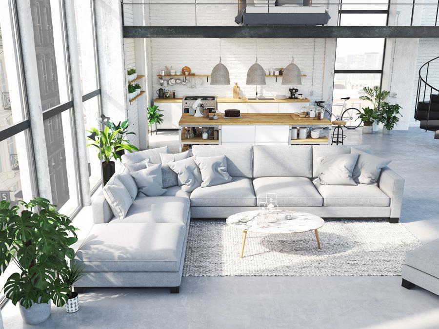 Cocina abierta al salón con gran sofá en L