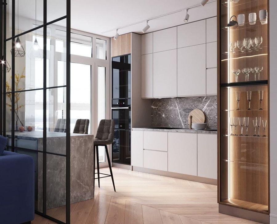 Cocina de estilo moderno con mobiliario hasta arriba
