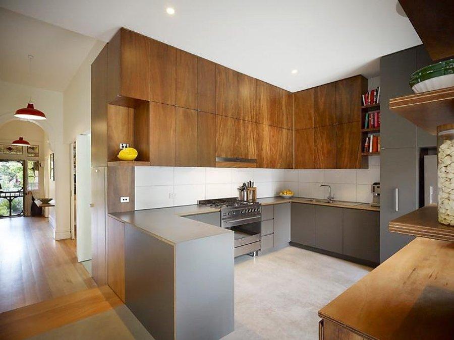 Cualquier lugar es bueno para cocinar integra tu cocina for Cocinas en u con barra