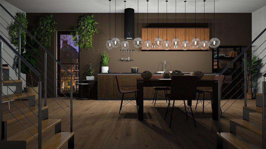 Cocina en tonalidad negra con gran lámpara de techo