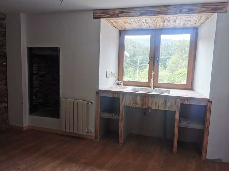 cocina mobiliario de obra y revestido en madera