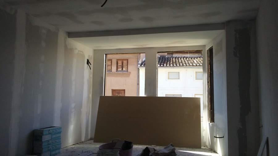 Colocación de trasdosado de Pladur en paredes exteriores.