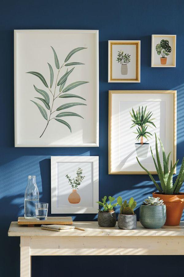 C mo crear una galer a de cuadros en tu pared ideas - Como colocar cuadros ...