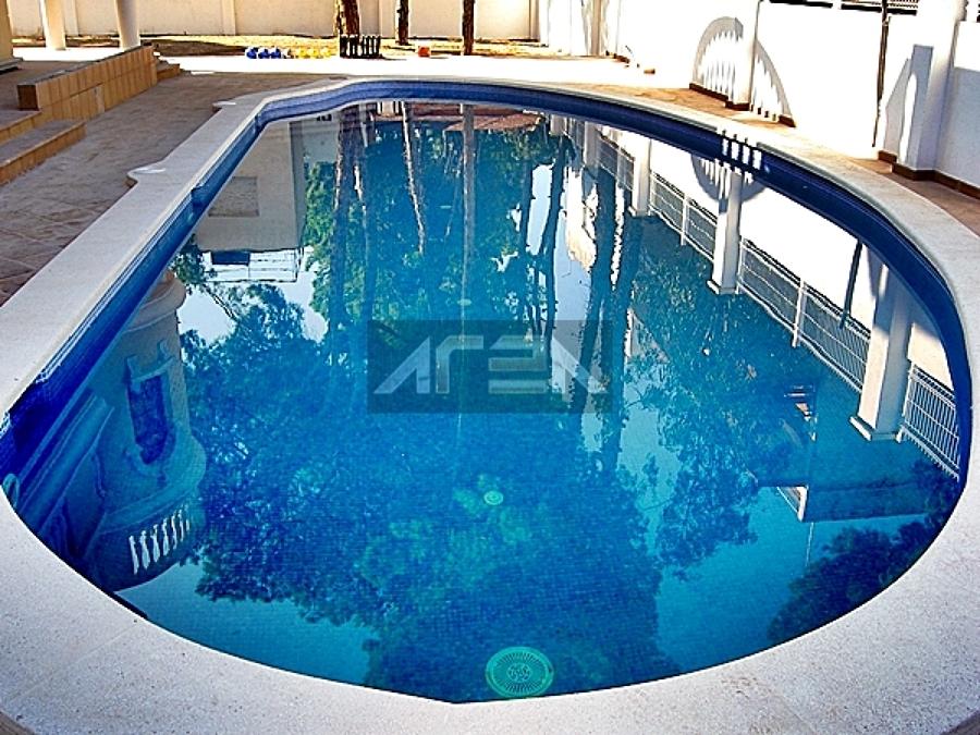 Proceso de construcci n de una piscina de obra climatizada for Piscina castelldefels