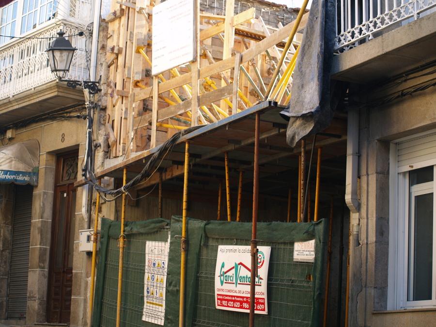 Construir casa entre dos viviendas