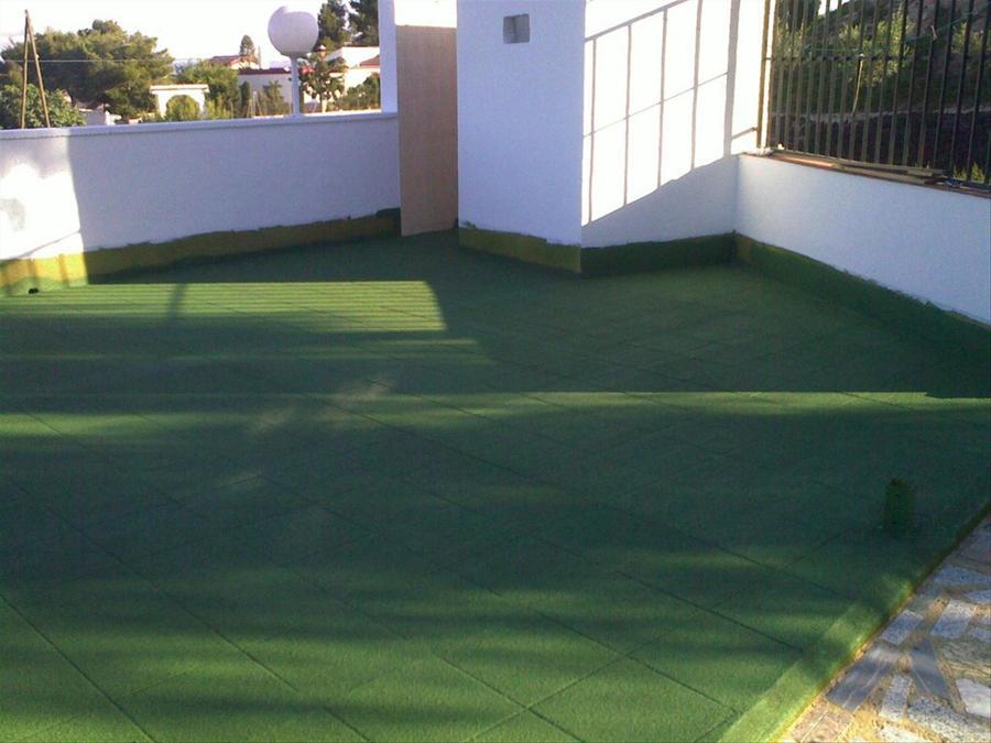 Corcho proyectado en suelo de piscinas ideas reformas for Piscinas sobre suelo