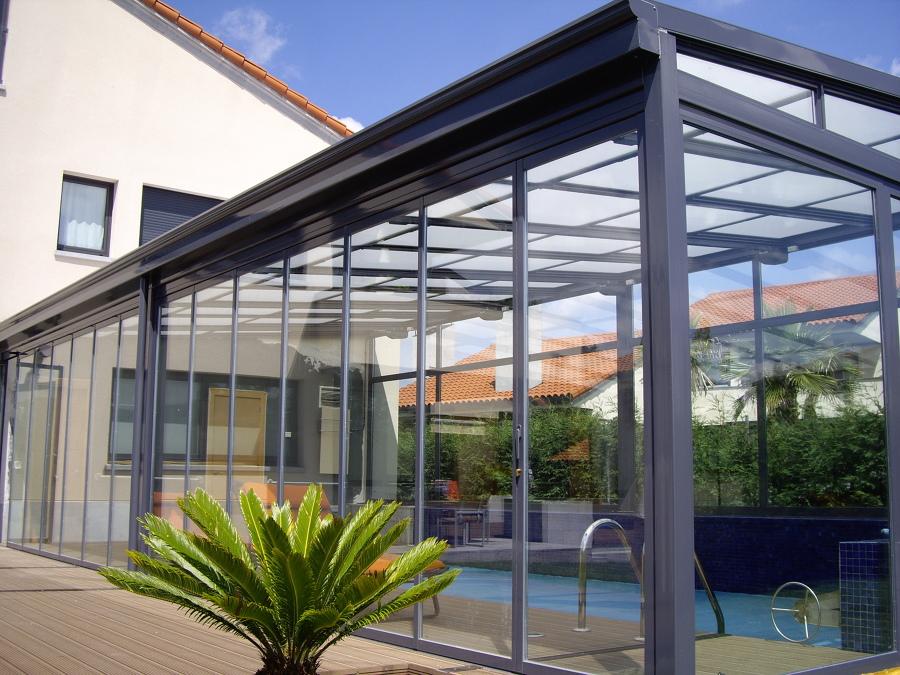 Cortina de cristal con aislamiento térmico y techo móvil Kauma