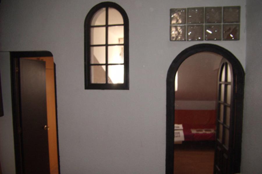 División entre habitación y salón anterior