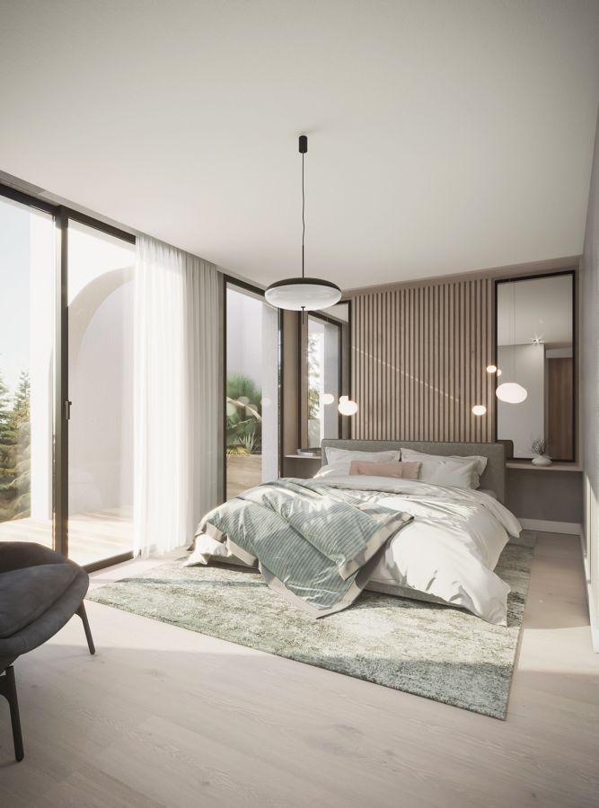 Dormitorio amplio en tonos tierra y verdes