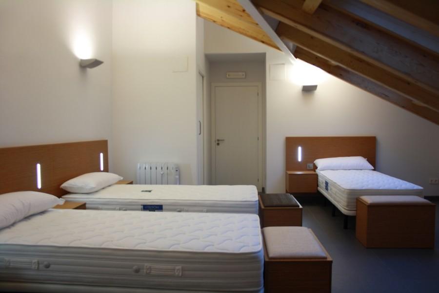 Dormitorio común en Bajo Cubierta