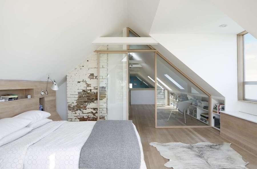 Dormitorio con cabecero madera laminada