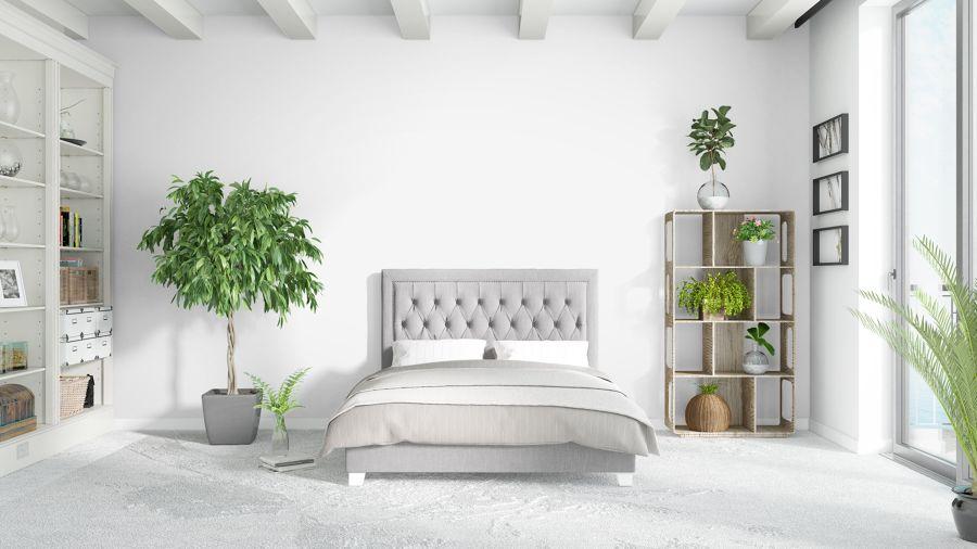 Dormitorio con cama y cabecero de capitoné