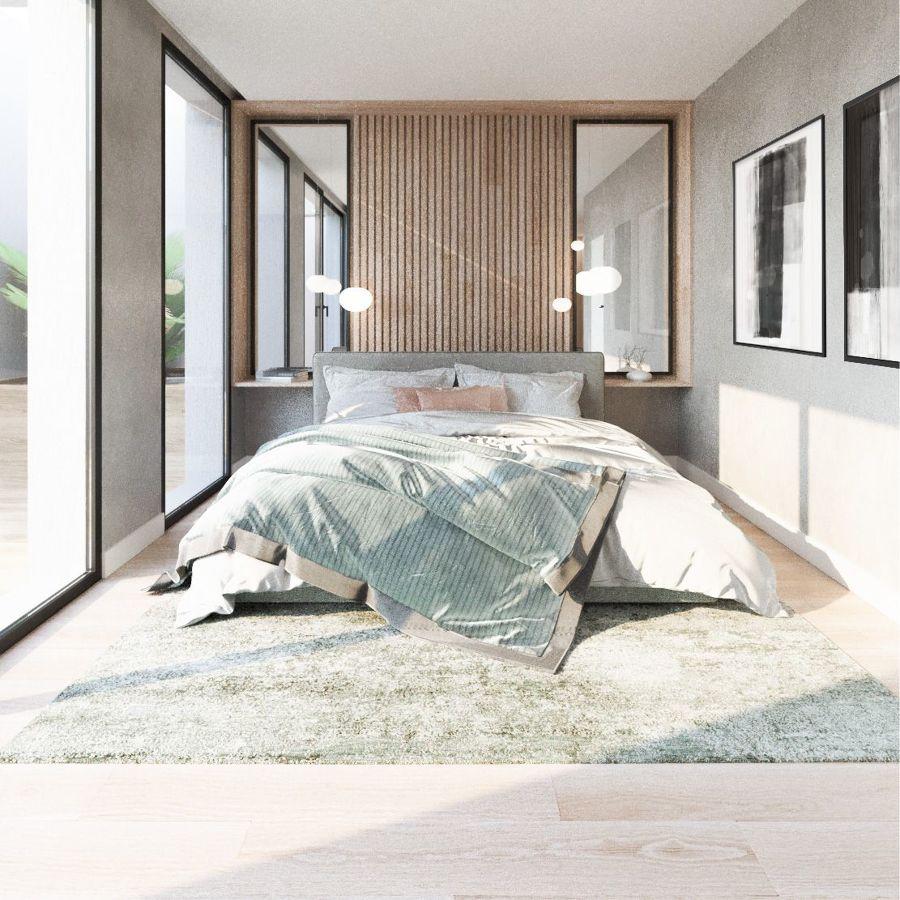 Dormitorio con grandes ventanales