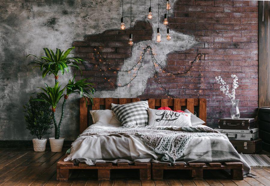 Dormitorio con pared de ladrillo vista