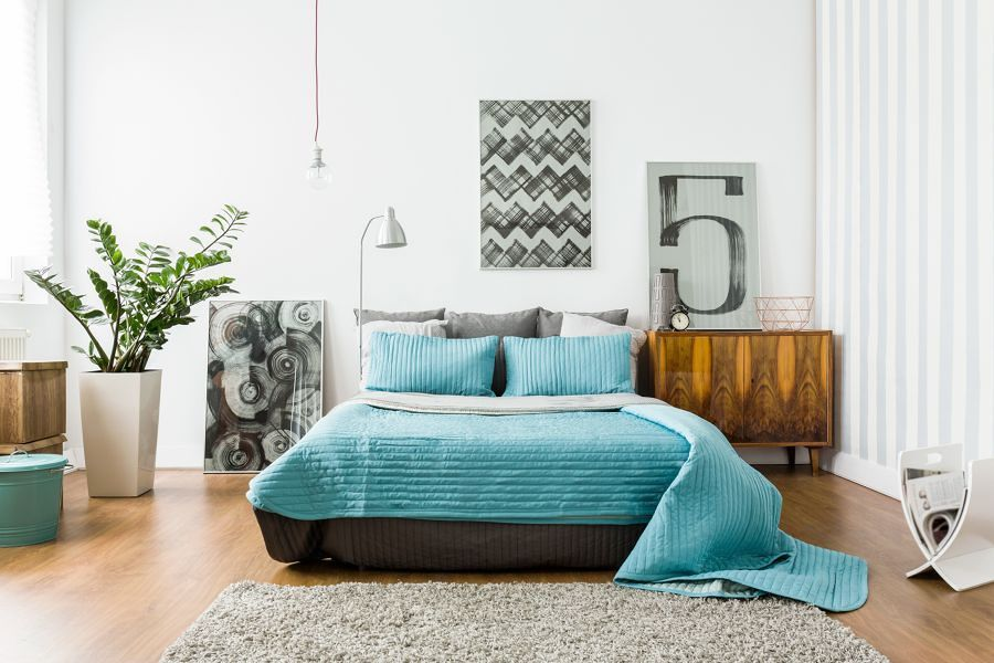 Dormitorio con textiles en azul