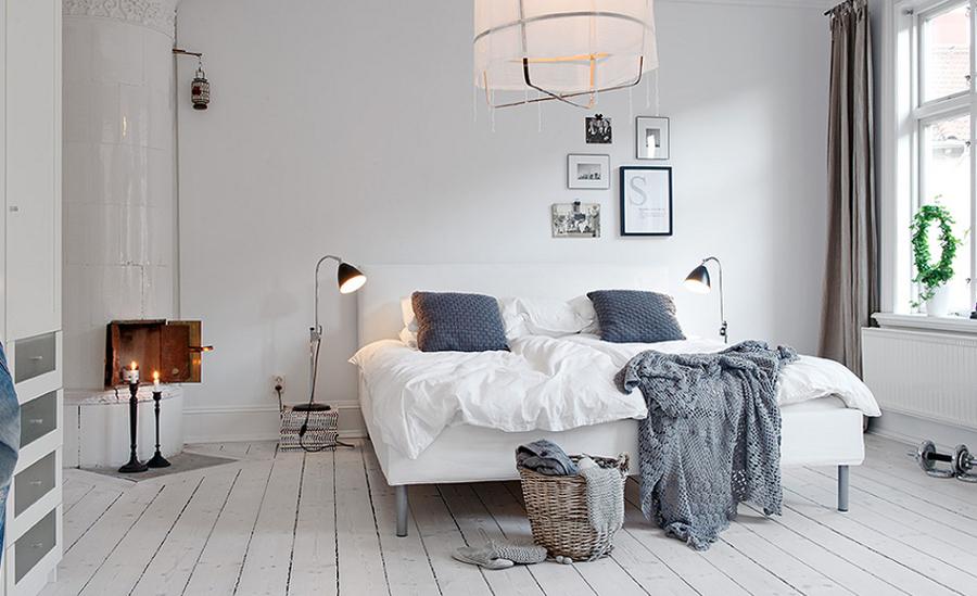 Dormitorio con textiles en gris
