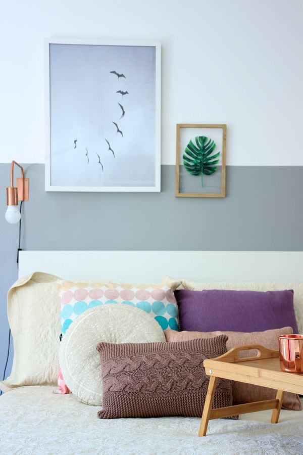 Dormitorio con textiles y cojines de colores