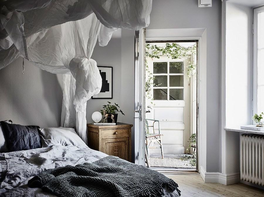 Dormitorio en blanco y gris