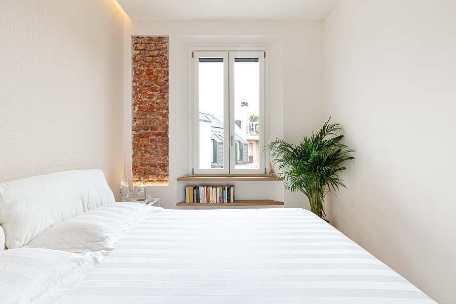 Dormitorio minimalista en blanco