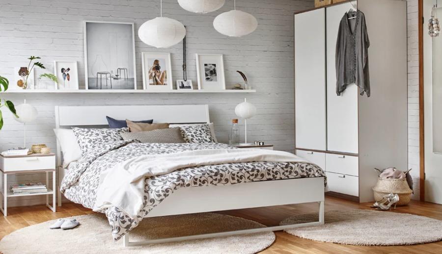 Dormitorio moderno con cabecero de papel pintado