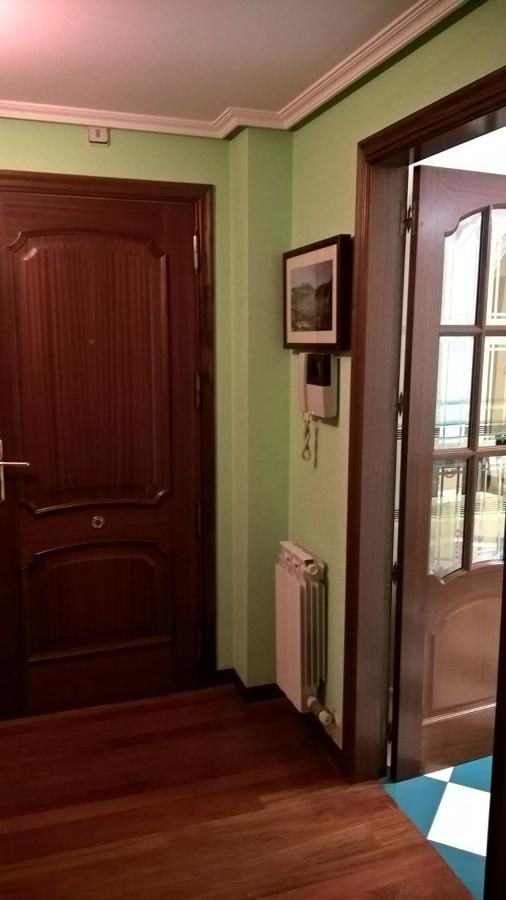 Entrada a piso y acceso a cocina