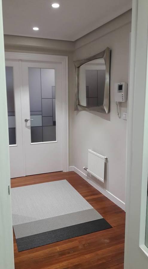entrada con alfombras vinílicas