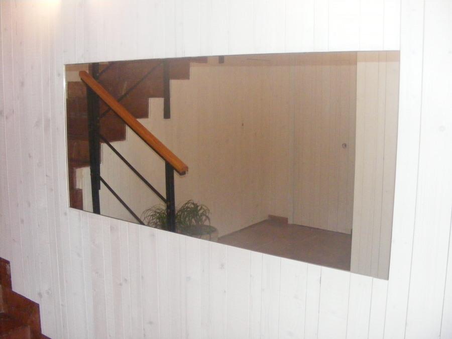 Espejo colocado para dar amplitud