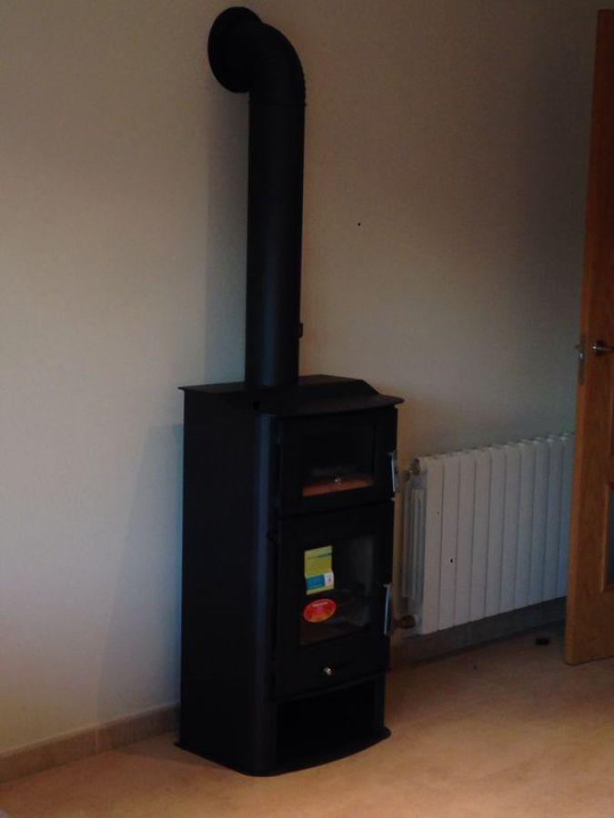 Foto estufa de le a de ventilaciones conducciones air - Instalacion estufa lena ...