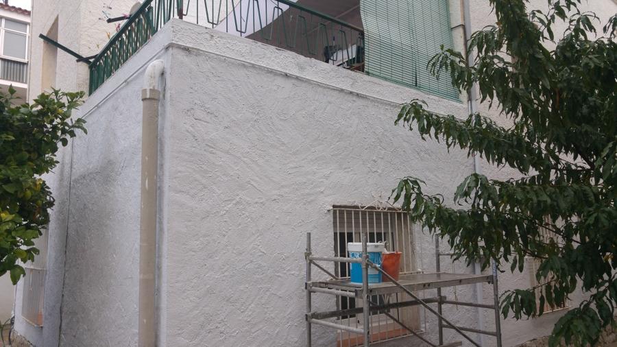 Finalizado en mortero de reparación y pintura
