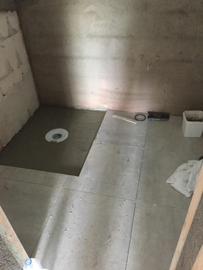 Formación de plato de ducha de obra