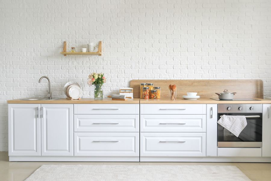 Frente de cocina con encimera de madera