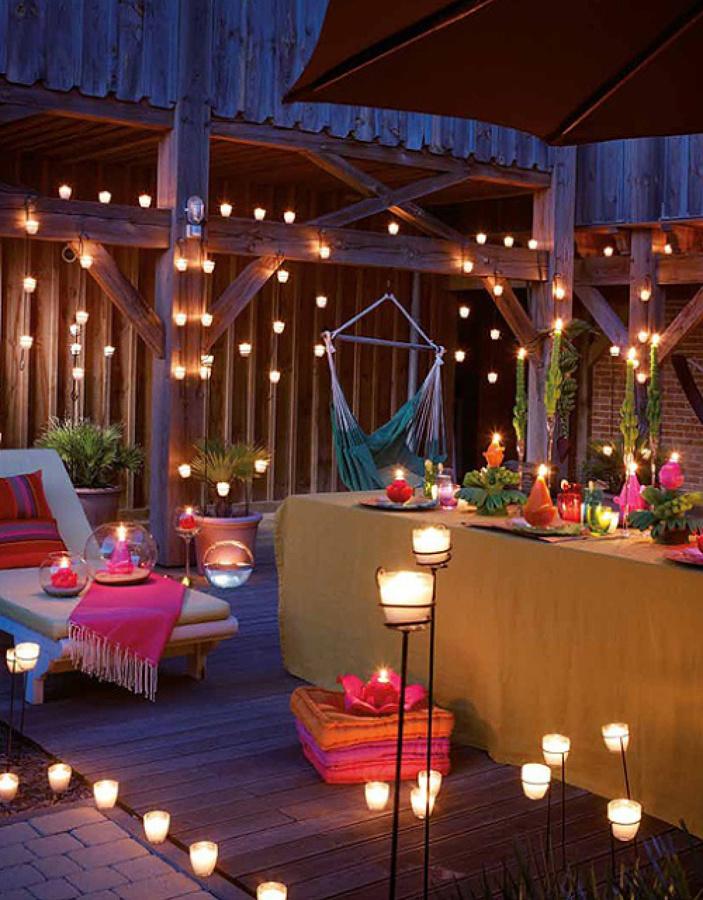 Iluminación terrazas con guirnaldas y velas