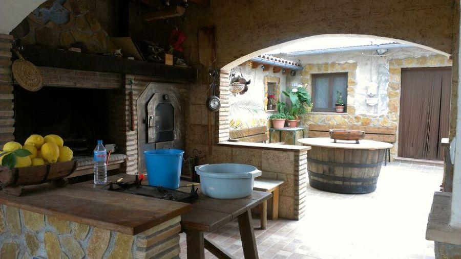 Barbacoa y horno de obra ideas alba iles for Casetas para guardar lena
