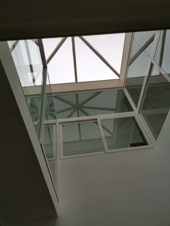 limpieza de cristales en altura de vivienda interior