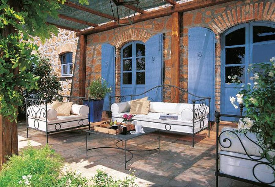 Dise o de porches y terrazas moda en auge para ganar confort ideas reformas viviendas - Decorar un porche cerrado ...