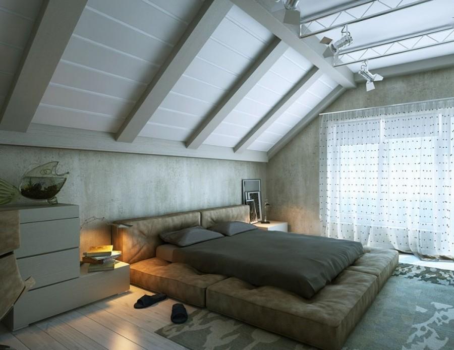 Muebles bajos en un dormitorio abuhardillado