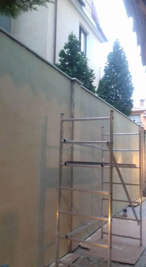 muro entre vecinos