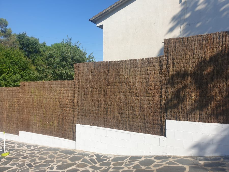 Muro, vallado y sistema de ocultación