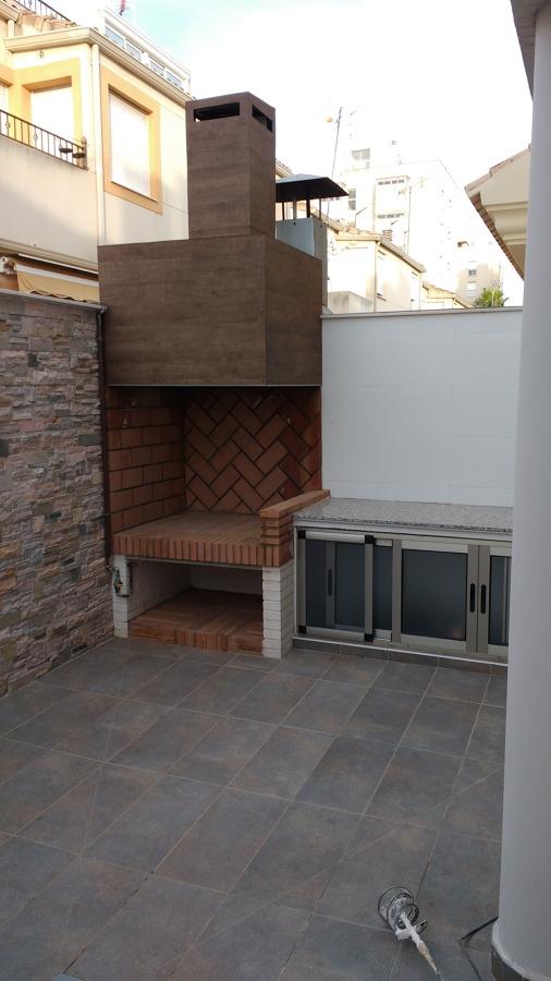 Paellero en patio valencia ideas reformas viviendas - Paelleros de obra modernos ...