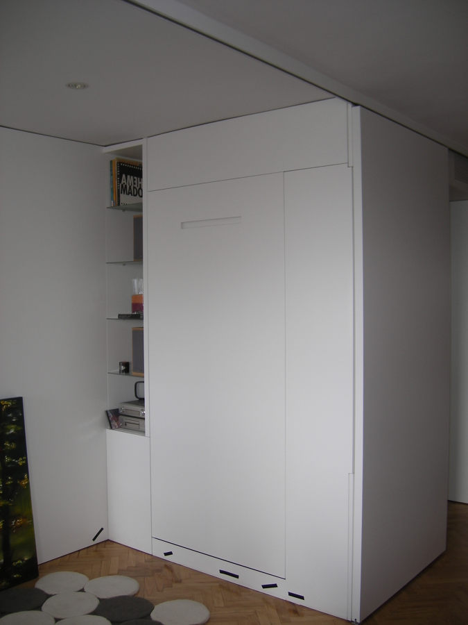 panelados que forman habitacion y cama oculta