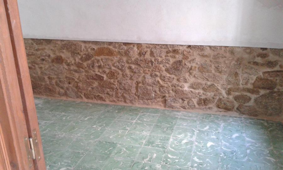 picado y enlucido de piedra natural en paredes rusticas