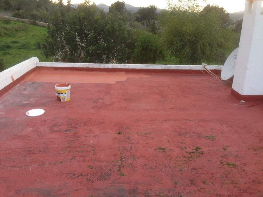 Pintando con malla y cloro caucho para nueva impermeabilización