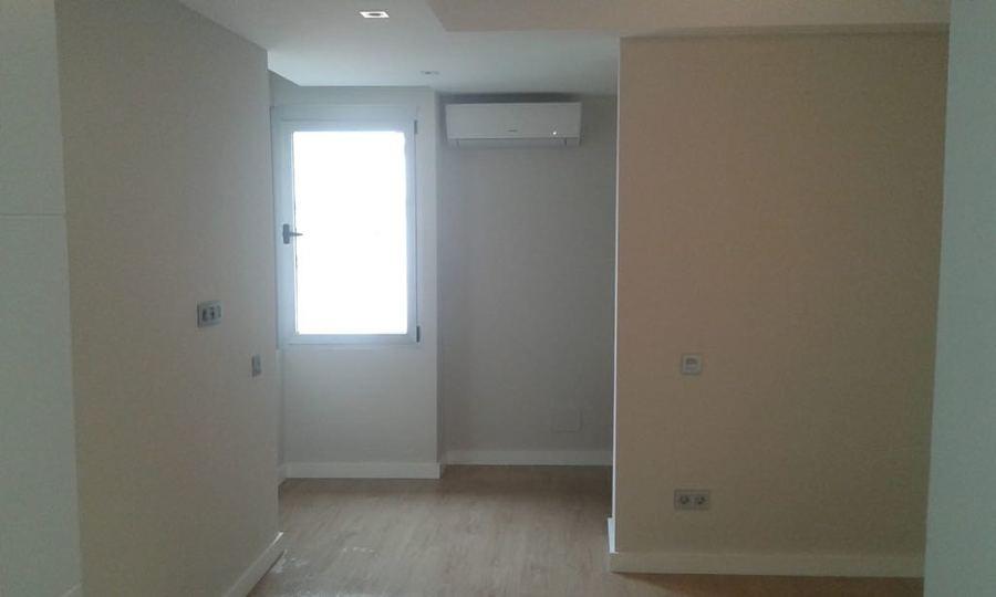 pintura interior de vivienda pasillo y entrada