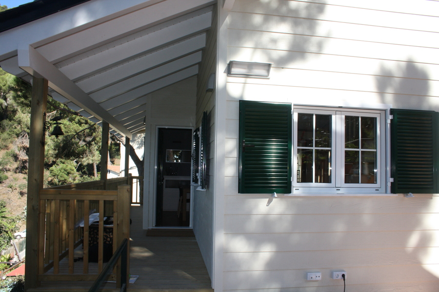 Foto porche de carpenter house construcci n de casas de for Porche americano