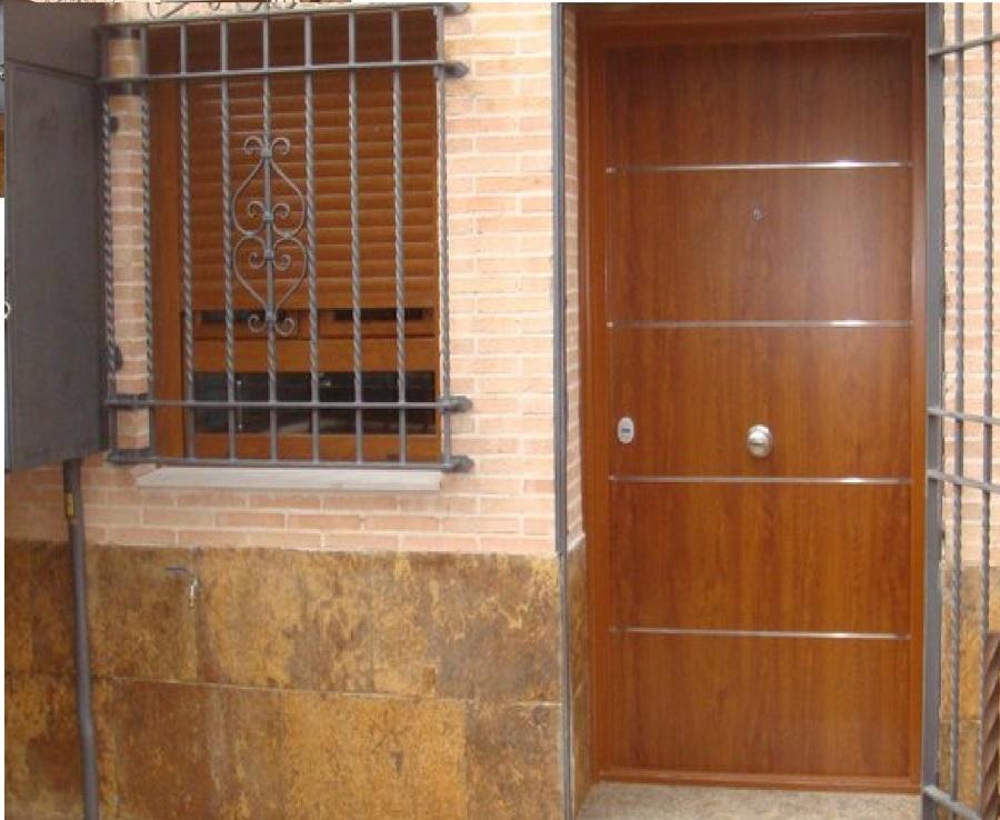 Puertas acorazadas para exterior ideas carpinteros for Puertas de aluminio imitacion madera exterior precios