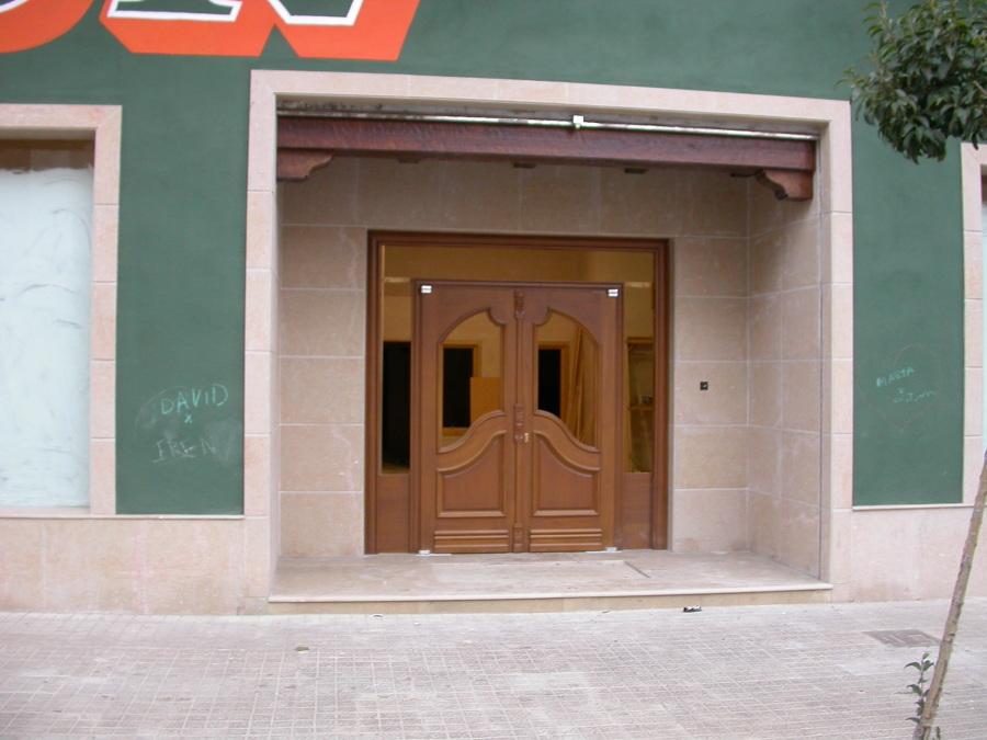 Puerta Calle 2 hoja con fijo y montante cristal