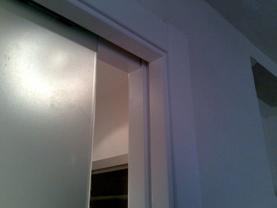 Foto puerta corredera de cristal de area 3 estudio de for Puerta corredera cristal